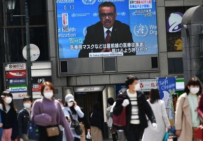 World Health Organization president Tedros Adhanom Ghebreyesus in a press conference broadcast on a screen in Japan.