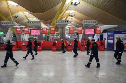 Military Emergency Unit members disinfecting Madrid's Adolfo Suarez Barajas Airport.