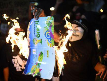 Protesters burn a World Cup brochure in Rio de Janeiro.