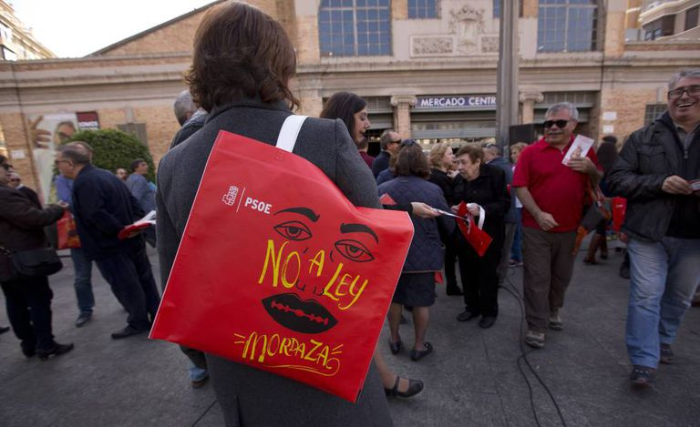 """Bag reads """"No to the gag law."""""""