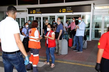 A group of passengers at Lanzarote airport on Friday.