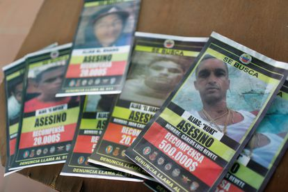 Wanted posters for members of El Koki's criminal gang are seen after armed confrontations between gang members and police forces in the Cota 905 neighborhood, in Caracas