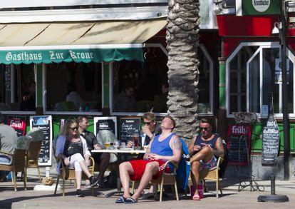 German tourists at a beachfront bar in Palma de Mallorca.