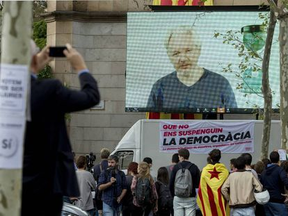 Julian Assange speaks to university students in Barcelona on Tuesday via videolink.