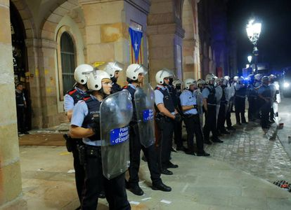 Catalan police form a protective line in front of the parliament.