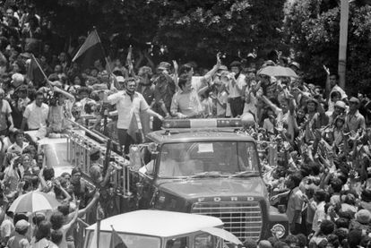 Members of the provisional Sandinista government greet the crowds in Managua after the guerrillas' victory in 1979.