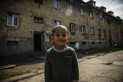 A child on Riegrova street. His grandmother, Mrs Horváthová, says living conditions have improved greatly since they arrived here seven years ago.