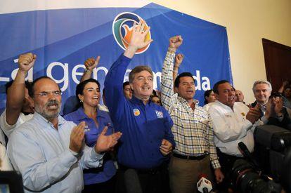 "Francisco ""Kiko"" Vega (blue shirt) celebrates his victory with supporters."
