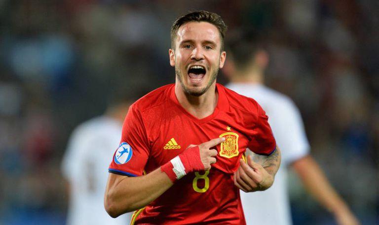 Saúl celebrates one of his three goals against Italy.