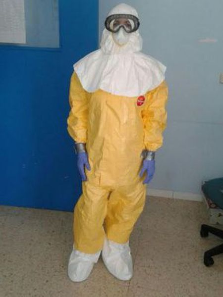 A healthcare worker who treated Miguel Pajares wearing a protective suit and gloves attached with duct tape.