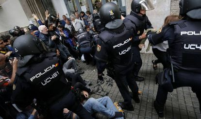 Police break up a group of voters on October 1 in Barcelona.