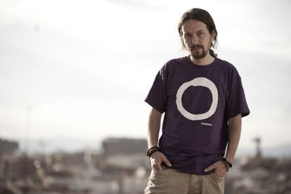 Podemos leader Pablo Iglesias wearing a T-shirt with the party logo.
