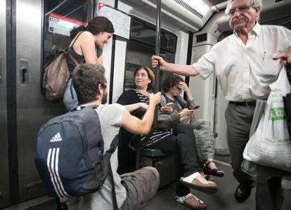 The new mayor of Barcelona, Ada Colau, takes the subway on Monday.