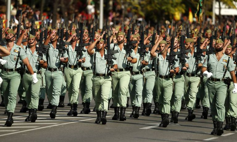 Members of La Legión marching on Spain's National Day, October 12.