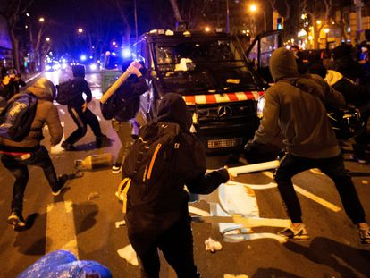 Protesters attacking a police van in Barcelona on Thursday.