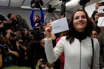 Ciudadanos candidate Ines Arrimadas shows her ballot before casting her vote for the Catalan regional election