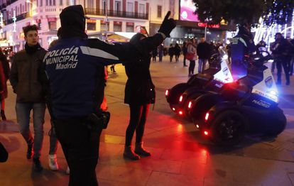 Madrid police telling people which way to walk along Preciados street.
