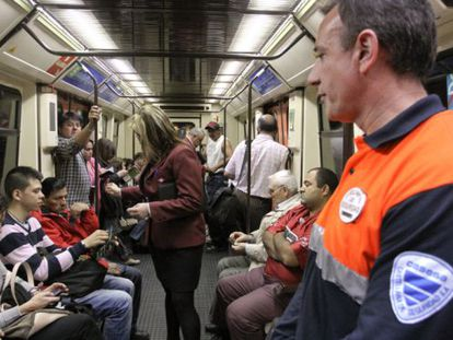 Madrid subway inspectors checking tickets in 2011.