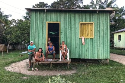 Residents of Punã in front of their home.