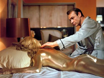 Sean Connery as James Bond in Goldfinger, with Shirley Eaton.