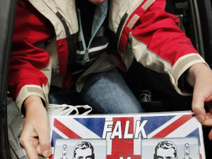 A Falklands resident shows off a sign that she placed in her car window last Thursday.