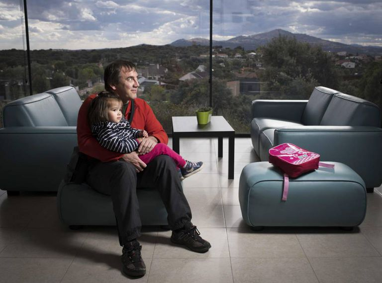 Jesús Fuente, 46, and his three-year-old daughter Irene, who live in Venturada, a town whose population has quadrupled in the past 20 years and now stands at 2,032.