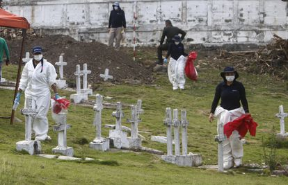 Forensic experts at an exhumation at Dabeiba cemetery on March 11.