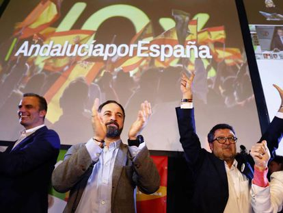 VOX party leader Santiago Abascal (center) and aides celebrate the election results.