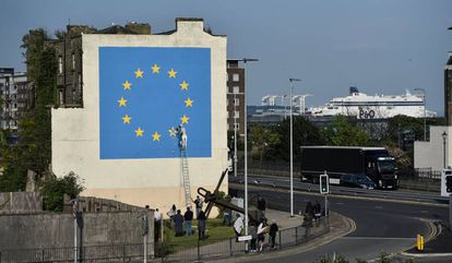 An artwork in the English port city of Dover attributed to street artist Banksy, depicting a workman chipping away at one of the 12 stars on the flag of the European Union.