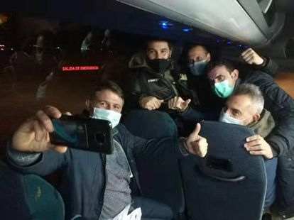Spaniards evacuated from Wuhan during their bus journey to a Madrid hospital.
