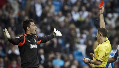 Real Madrid goalkeeper Antonio Adán is shown the red card on Sunday.