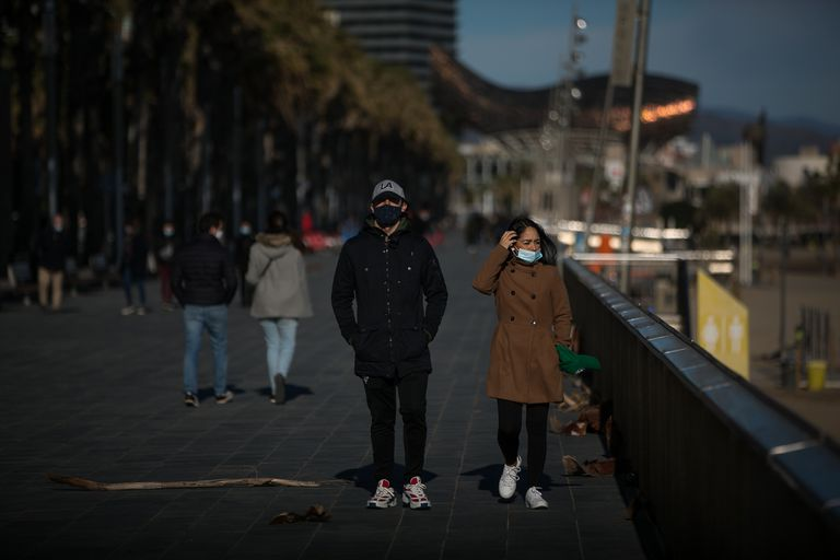 Passers-by wearing masks in Barcelona this week.