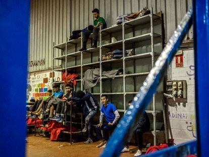 Moroccan unaccompanied minors sleeping in a warehouse in Ceuta on Tuesday.