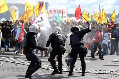 The march turned violent when small groups of anarchists attacked police.
