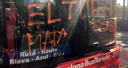 """The bus was sprayed with the words """"Tourism kills the barrio."""""""