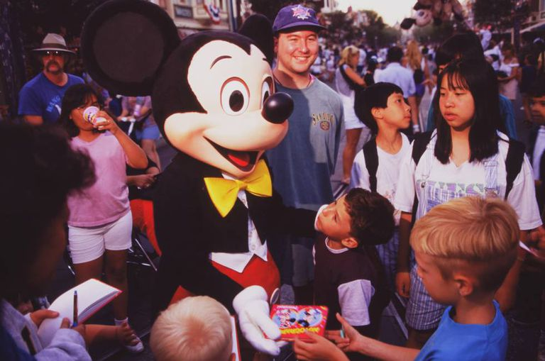 Mickey Mouse greets children at Disneyland Paris