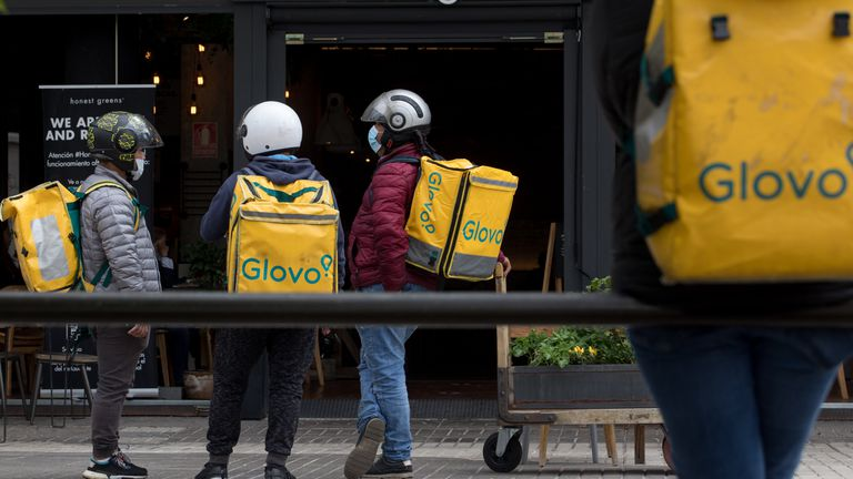 Glovo food delivery riders in Madrid.