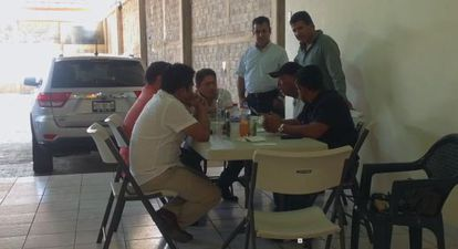 Screen capture from video showing La Tuta in a meeting with a former mayor and other Michoacán officials.