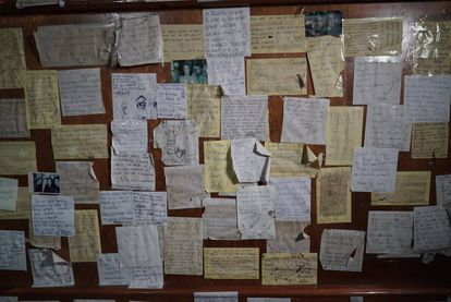 A board where patrons hang notes about their experiences in the bar.