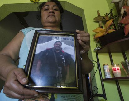 Blandina Ponce with a photograph of her son, who she says was murdered by police in Villa Juárez. Sinaloa.