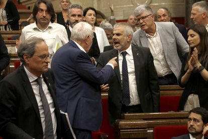 Angry scenes between lawmakers inside the Catalan parliament on Thursday.