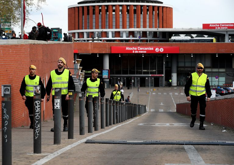 Members of the Emergency Military Unit patrol the Atocha train station in Madrid to ensure that people respect the coronavirus lockdown.