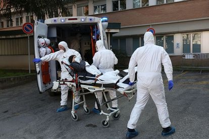 A coronavirus patient is moved in Italy on February 22.