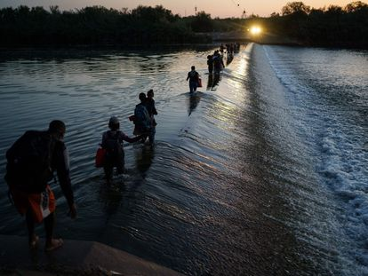 A group of Haitian migrants crosses the Rio Bravo in search of food and supplies near the Del Rio-Acuña border crossing in Acuña, Mexico.