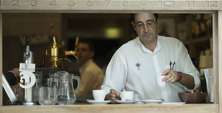 A waiter in Seville.