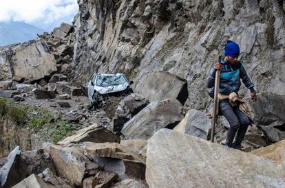 A Nepalese man walks over fallen rocks on the way to Dhunche, a village in Langtang National Park.