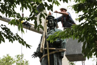A statue of Christopher Columbus about to be removed from Wooster Square Park in New Haven, Connecticut.
