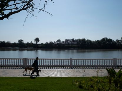 A man walks by the Guadalquivir River in Coria del Río.