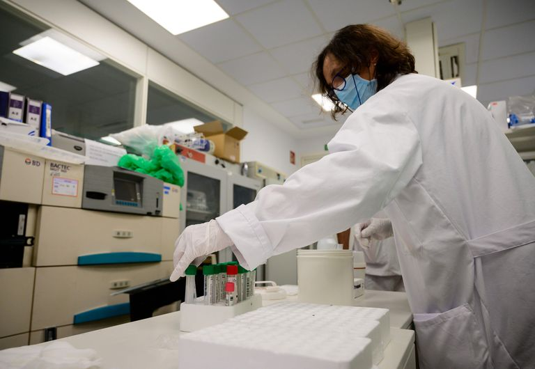 A scientist handles a PCR coronavirus tests at the microbiology laboratory of the Gregorio Maranon General Hospital in Madrid.