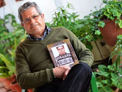 Guillem Agulló Sr holds a photograph of his son.
